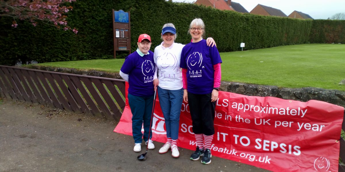 Ladies committee members modelling FEAT (Sepsis Scotland) T shirts and stripey socks