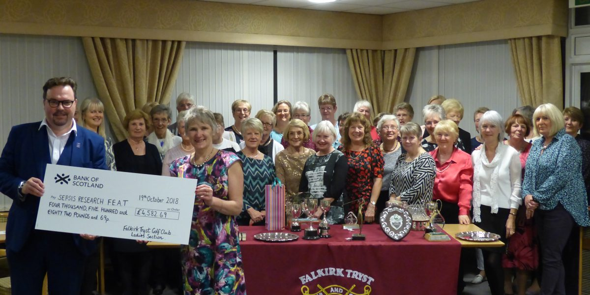 Presentation of Fundraising cheque to FEAT at prizegiving Dinner